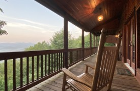 Happy Ours Lodge | Cabin Rentals of Georgia | Rocking Chair Overlooking Sunrise Mountain View