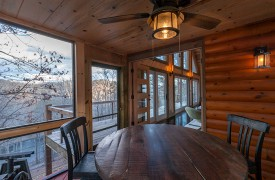 River Heights Lodge | Cabin Rentals of Georgia | Screened-in Al Fresco Dining Overlooking Toccoa River