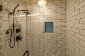 River Heights Lodge | Cabin Rentals of Georgia | Custom Tile Shower on Main Level