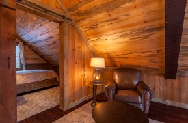 River Heights Lodge | Cabin Rentals of Georgia | Sitting Area in Loft attached to Queen Bedroom
