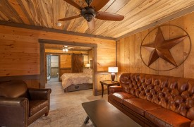 River Heights Lodge | Cabin Rentals of Georgia | Terrace Level King Suite Private Living Are