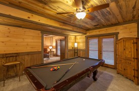 River Heights Lodge | Cabin Rentals of Georgia | Terrace Level Pool Table with Access to Private Living Space of King Master Suite