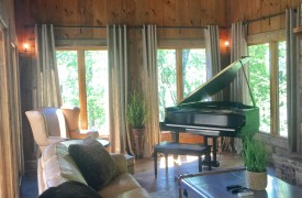 A Mayfly Lodge & Treehouse | Cabin Rentals of Georgia | Grand Piano with leather furnishings, fireplace, TV, game table