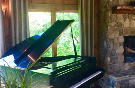 A Mayfly Lodge & Treehouse | Cabin Rentals of Georgia | Treehouse Entertainment with grand piano, fireplace, TV, game table, leather furnishings