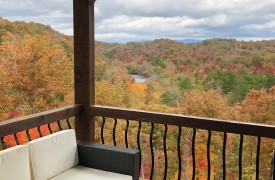 Outlaw Ridge | Cabin Rentals of Georgia | Sitting Outside autumn w/ fall colors overlooking Toccoa River go through North GA mountains