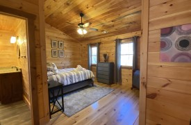 Our True Blue | Blue Ridge Cabin Rentals | Cabin Rentals of Georgia | Queen bed in sleeping loft w/ luxury linens
