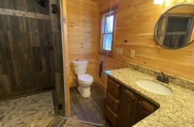 Our True Blue | Blue Ridge Cabin Rentals | Cabin Rentals of Georgia | upstairs full bath with double vanities, large custom walk-in shower