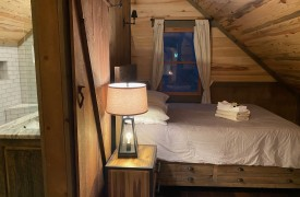 River Heights Lodge | Cabin Rentals of Georgia | Upstairs Cozy Queen Bedroom w/ En-suite Bath