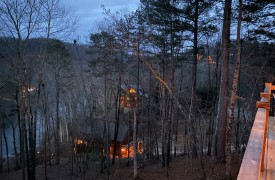 River Heights Lodge | Cabin Rentals of Georgia | Dusk view of Large Gathering Luxury Blue Ridge Cabins Overlooking Toccoa River