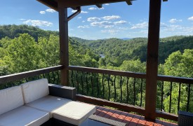 Outlaw Ridge | Cabin Rentals of Georgia | Sitting Outside in summertime overlooking Toccoa River go through North GA mountains