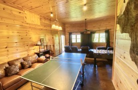 Outlaw Ridge | Cabin Rentals of Georgia | Terrace Level Game Room w/ Ping Pong, Foosball, and Leather Furnishings
