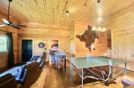 Outlaw Ridge | Cabin Rentals of Georgia | Terrace Level Game Room Ping Pong and Foosball