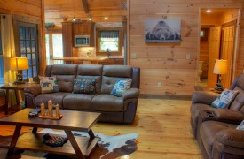 Lazy Creek Retreat | Cabin Rentals of Georgia | Open Floor Plan Living into Kitchen and Dining
