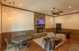 A Mayfly Lodge & Treehouse | Cabin Rentals of Georgia | Terrace Level Game Room with bean bag chairs, game table, foosball, fireplace and TV