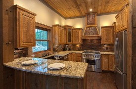 A Mayfly Lodge & Treehouse | Cabin Rentals of Georgia | Gourmet Kitchen with Thor 6-burner stove/oven