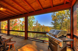 A Rustic Elegant Retreat | Blue Ridge Luxury Cabin Rentals | Cabin Rentals of Georgia | Gas grill overlooking nice backyard and layered mountains in autumn