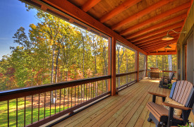 A Rustic Elegant Retreat | Blue Ridge Luxury Cabin Rentals | Cabin Rentals of Georgia | Porch living with rockers looking at mountain views