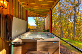 A Rustic Elegant Retreat | Blue Ridge Luxury Cabin Rentals | Cabin Rentals of Georgia | terrace level hot tub overlooking mountain views with fall foliage