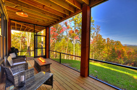A Rustic Elegant Retreat | Blue Ridge Luxury Cabin Rentals | Cabin Rentals of Georgia | outdoor seating with firetable and mountain views in fall foliage