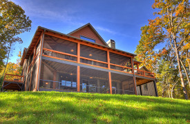 A Rustic Elegant Retreat | Blue Ridge Luxury Cabin Rentals | Cabin Rentals of Georgia | Back Exterior during fall foliage