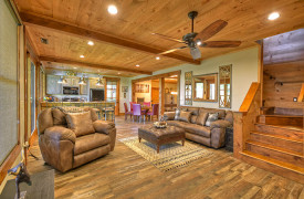 A Rustic Elegant Retreat | Blue Ridge Luxury Cabin Rentals | Cabin Rentals of Georgia | Terrace level luxurious living room w/ leather furnishings