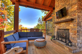 A Rustic ElegantRetreat | Blue Ridge Luxury Cabin Rentals | Cabin Rentals of Georgia | Outdoor Living with TV, fireplace, mountain views, alfresco dining