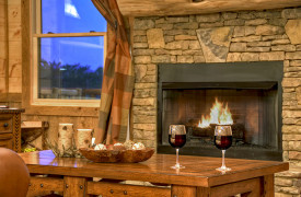 Heartwood Lodge | Cabin Rentals of Georgia | Wood-Burning Fireplace in Living Area