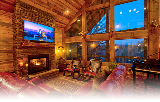 Luxe living room with fireplace, a luxury Blue Ridge cabin rental from Cabin Rentals of Georgia