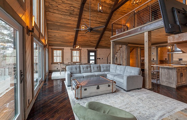 River Heights Lodge | Cabin Rentals of Georgia | Spacious Living, Dining, Kitchen Area w/ Large Windows to the View
