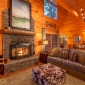 CozyLivingAreafeaturingBeautifulWood-BurningFireplace&PlushFurnishings