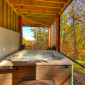 State-of-the-artbluetoothhottubinscreened-inporchoverlookingfallfoliage