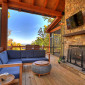 Beautifuloutdoorlivingwithwood-burningfireplaceandTV